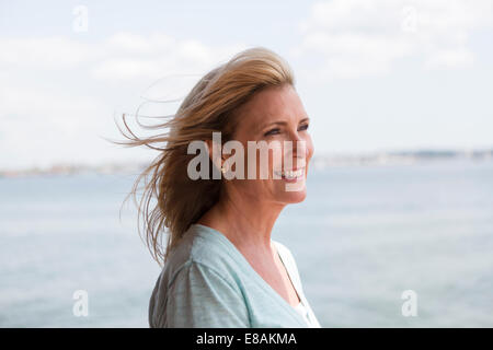 Mature woman with blonde hair, portrait - Stock Photo