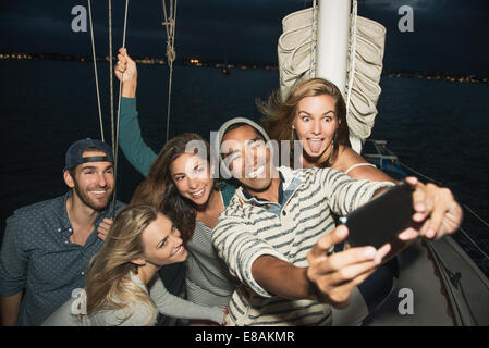 Friends on sailing boat photographing themselves - Stock Photo