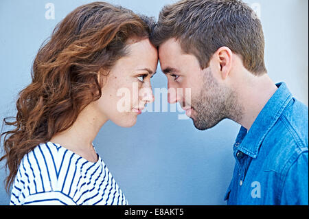 Close up of couple forehead to forehead - Stock Photo