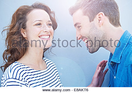Close up of couple laughing - Stock Photo