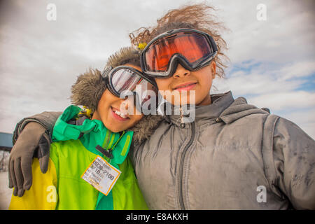 Portrait of children in ski goggles - Stock Photo