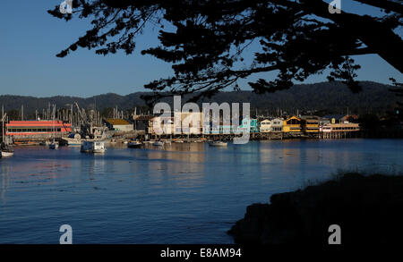A view of Fisherman's Wharf Monterey Bay California in the setting suns golden light - Stock Photo