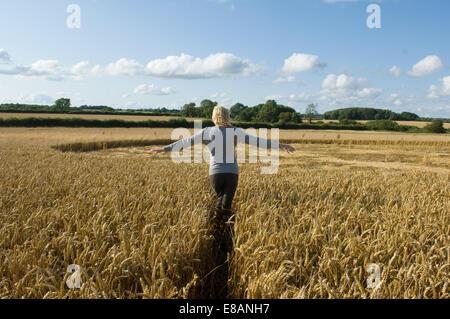Woman on field - Stock Photo
