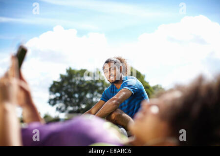 Young couple taking a break in park - Stock Photo