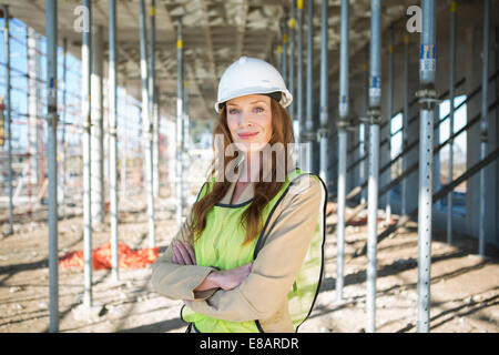 Portrait of site manager on construction site - Stock Photo