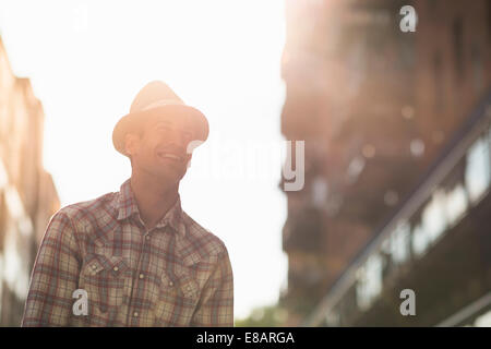 Young man wearing hat and checked shirt - Stock Photo