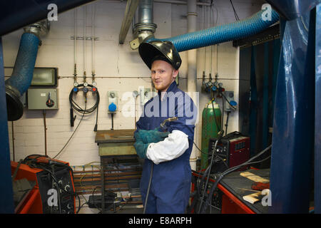 Portrait of male student welder in college workshop - Stock Photo