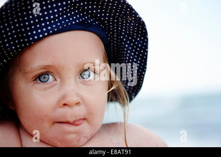Young girl wearing spotty hat, portrait - Stock Photo