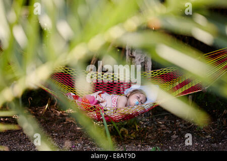 Young girl asleep in hammock - Stock Photo