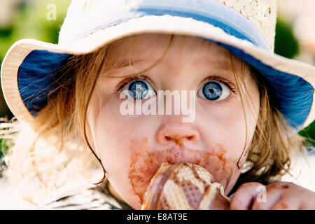 Young girl eating ice cream cone - Stock Photo