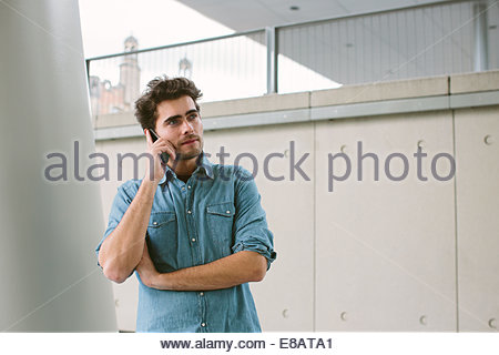 Young man on cell phone - Stock Photo