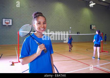 Young woman on badminton court, portrait - Stock Photo