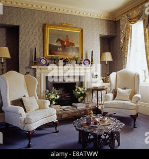 Charmant ... Cream Wing Chairs On Either Side Of Fireplace In Living Room With A  Carved Indian