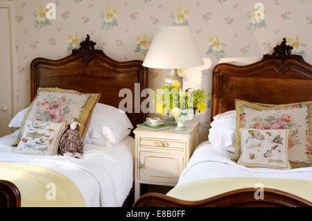Antique mahogany twin beds with white bedlinen in cream country ...