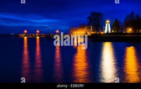 Concord Point Lighthouse and a pier at night in Havre de Grace, Maryland. - Stock Photo
