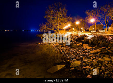 The Chesapeake Bay waterfront in Havre de Grace, Maryland at night. - Stock Photo