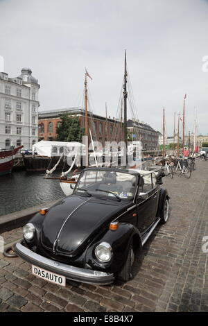 A classic black Volkswagen Beetle car in Nyhavn, Copenhagen, Denmark. Unique registration plate 'DAS AUTO' - Stock Photo