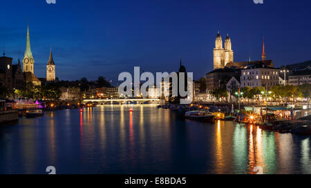 The old town of Zurich at night with the river Limmat, Switzerland - Stock Photo