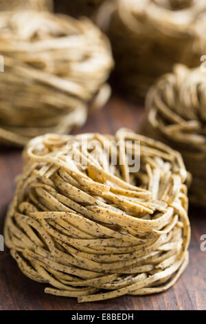 Tajarin or Tagliolini, made with fresh eggs and buckwheat flour, a specialty pasta shape from Piemonte, region of - Stock Photo