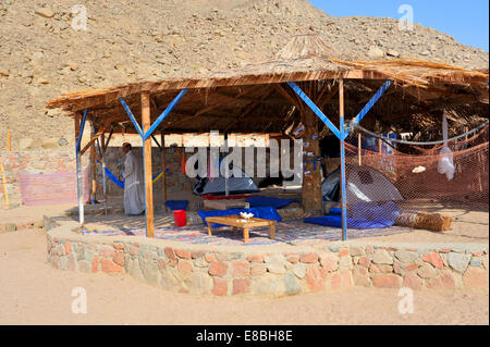 Tourist rest and eating area in Bedouin village camp in southern Sinai Peninsula along Red Sea Gulf of Aqaba - Stock Photo