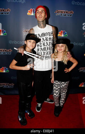 NEW YORK-SEP 17: Drummer Travis Barker (C) with son Landon (L) and daughter Alabama attend the post-show red carpet - Stock Photo