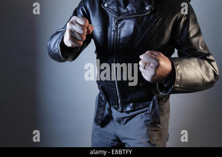 Male threatening violence with fists torso shown - Stock Photo
