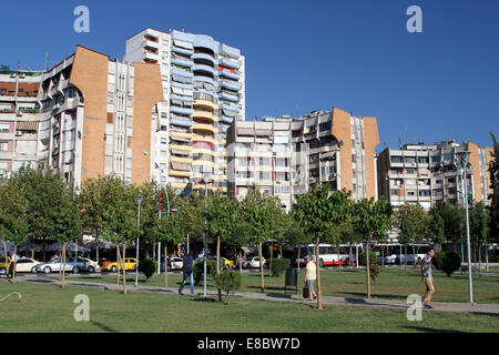 Apartment buildings overlooking a park in central Tirana, Albania - Stock Photo