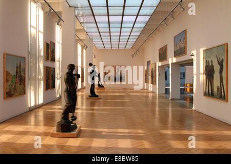 Communist-era art on display inside the National Art Gallery in Tirana, Albania. - Stock Photo