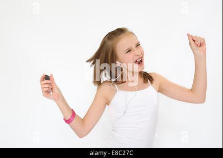 Teenager girl jamming listening mp3 player