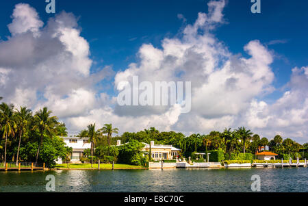 Houses along Collins Canal, in Miami Beach, Florida. - Stock Photo