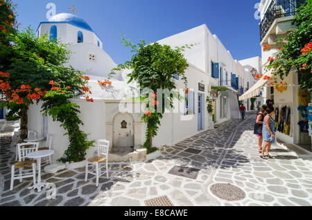 Greek water fountain and blue domed church in the whitewashed streets of Parikia Town on the island of Paros, Cyclades, - Stock Photo