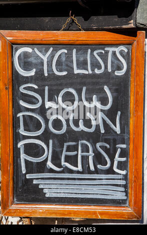 Cyclists Slow Down Please sign in hawkshead, Lake District, Cumbria - Stock Photo
