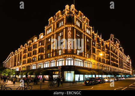 LONDON, UK - SEPTEMBER 25, 2014: The famous Harrods department store in the evening of September 25, 2014 at Knightsbridge - Stock Photo