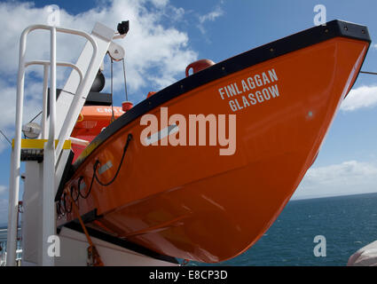 Caledonian Macbride (CalMac) car ferry Finlaggan en route from Kennacraig to Islay Port Askaig - Stock Photo