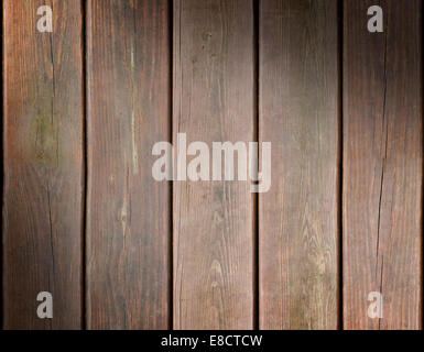 Weathered wooden plank background texture lit diagonally - Stock Photo