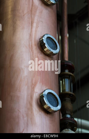 close up of a new copper alcohol still - Stock Photo