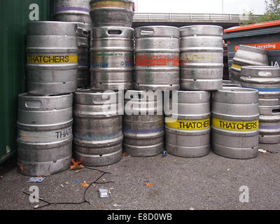 Empty Beer Barrels stored at the back of a pub - Stock Photo