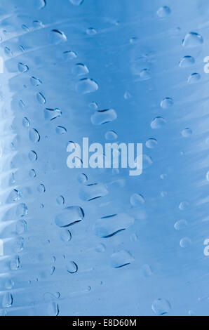 waterdrops on transparent bottle background - Stock Photo