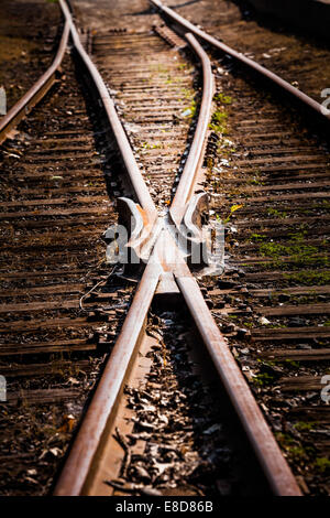 Rusty Train Track Rails Detail on a sunny Summer Day - Stock Photo