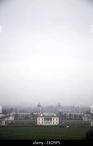 Recognisable London landmarks such as Canary Wharf and the Isle of Dogs are completely shrouded in a thick layer - Stock Photo
