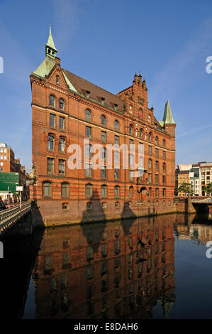 Sandthorquaihof in the morning light, a former office building of the HLFG, in front Kleines Fleet canal, Speicherstadt - Stock Photo