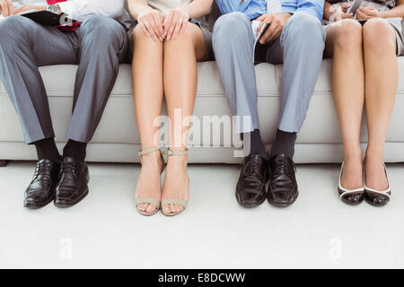Low section of executives waiting for interview - Stock Photo