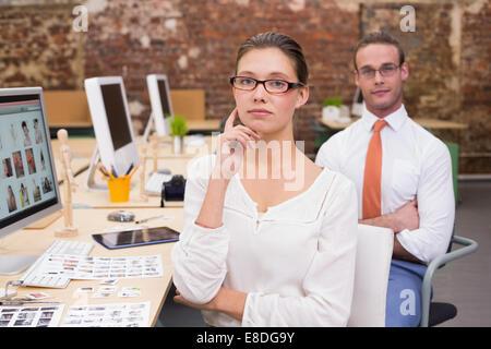 Portrait of photo editors in office - Stock Photo
