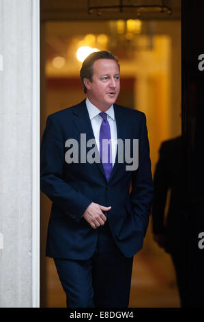 London, UK. 6th October, 2014. British Prime Minister David Cameron waits for the arrival of French Prime Minister - Stock Photo