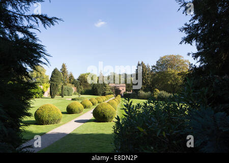 Topiary leading from the gatehouse at Berrington Hall near Leominster, Herefordshire, England, UK - Stock Photo