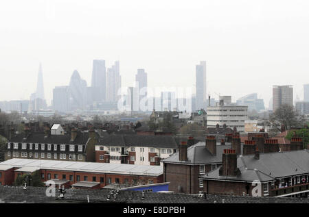 Recognisable London landmarks are shrouded in a thick layer of smog which has blanketed the city for the past few - Stock Photo