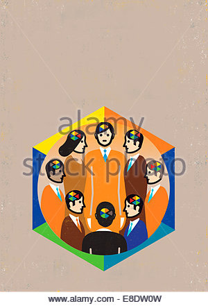Different pie charts inside heads of business people meeting in circle - Stock Photo