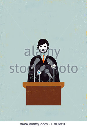 Politician making speech at podium with microphones - Stock Photo