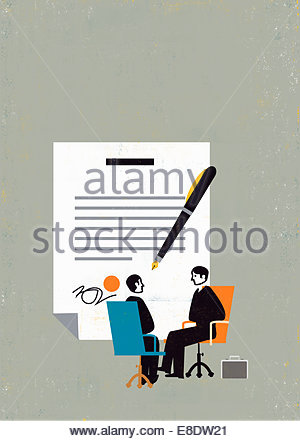Large pen and contract behind businessmen sitting in meeting - Stock Photo