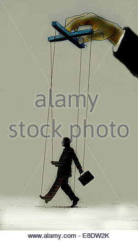 Hand controlling strings of puppet businessman - Stock Photo
